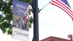 Welcome to Legendary Sturgis sign and American Flag Stock Footage