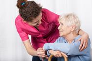 Stock Photo of nurse taking care of senior woman