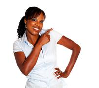 Stylish young woman looking at you pointing left - stock photo