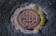 Stock Photo of Worn Street Water Main