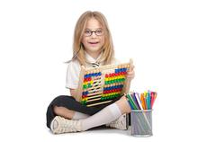 Small girl with abacus on white Stock Photos