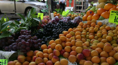 Fresh fruits in green grocer Stock Footage