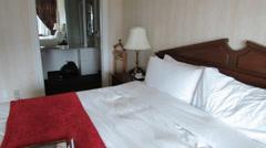 Hotel suite bedroom Stock Footage
