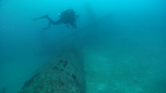 Full face mask diver swimming on wreckage in Solomon Islands, HD, UP18707 Stock Footage