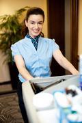Housekeeping executive pushing the cart Stock Photos