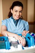 Cheerful executive standing behind the housekeeping cart Stock Photos