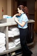 Pretty housekeeping executive busy working Stock Photos