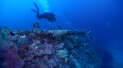 Ocean scenery lots of other divers in the distance, on wreckage, HD, UP18926 Stock Footage