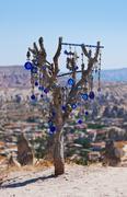 Tree and evil eye amulet in Cappadocia Turkey - stock photo