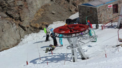 Ski lift is transporting people to the top of the ski hill. Stock Footage