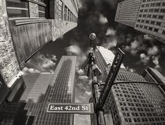 New York City - Manhattan Skyscrapers and Street Signs - stock photo