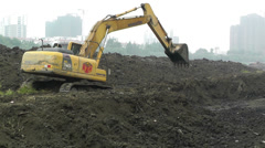 Riverbank Construction Sichuan China 2 machine Stock Footage