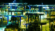 Stock Video Footage of 4K trading port activity cranes logistics night timelapse overview