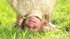 Children playing on the grass,Children jump, somersault, run. Stock Footage