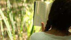 Beautiful Woman Reading a Book - Tracking Shot Stock Footage