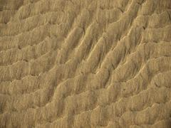 Ripples created by the water in sand 2 - stock photo