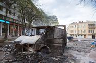 Stock Photo of burned car in the center of city after unrest