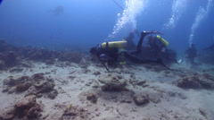 Ocean scenery mooring block in background, overweighted diver with full BCD Stock Footage
