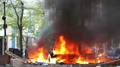 Burning car in the center of city during unrest in Odesa, Ukraine - stock footage