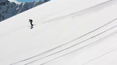 Skier on the snow field in the mountains Stock Footage