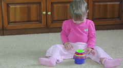Baby playing with a pyramid-cups Stock Footage