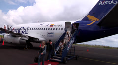 Passengers disembarking in San Cristobal, AeroGal, people or person in shot, HD, Stock Footage
