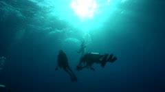 Group of scuba divers ascending in bluewater, HD, UP21396 Stock Footage