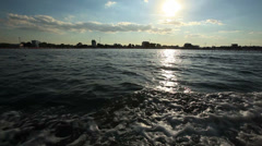 Black sea with fast yacht boat wake foam of prop wash Stock Footage