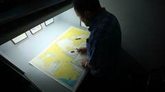 Cartographer making mesuraments Stock Footage