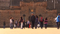 Crowd in front of the entrance of a monument-Asian girls taking pictures Stock Footage