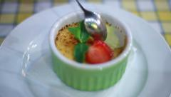 Creme Brulee Dessert with Berries. Close-Up. Stock Footage