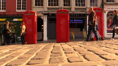 People are walking near the english call box in main street Stock Footage