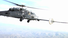 Air refueling Helicopters by a C-130 Hercules Stock Footage