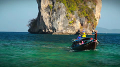 Classic boat near tropical islands with crystal clear water Stock Footage