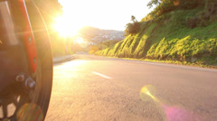 Motorcycle road POV sunset suburban Stock Footage