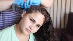 Stock Video Footage of A woman dyes the hair of adolescent girl MRL