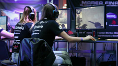 Gamers, girls team playng online video games at competition, multiplayer Stock Footage