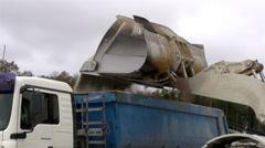 The big bulldozer transferring rocks Stock Footage