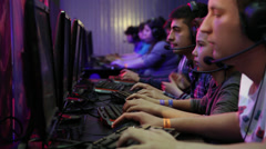 Gamers, teenagers, multiplayer, online video games, row of computers Stock Footage