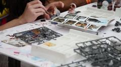 Citadel, Games Workshop, painting miniature figures for tabletop war games Stock Footage