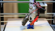 Stock Video Footage of 3D printer making a toy, three-dimensional, industrial robot, time  lapse