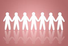 team of paper people on pink background - stock photo