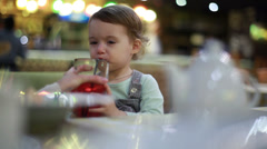 Baby drink juice from mother's hands Stock Footage