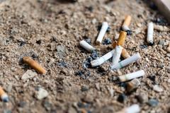 cigarette butts in ashtray sand truck - stock photo