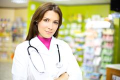 Happy pharmacist smiling at work Stock Photos