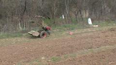 Cultivator beside fields Stock Footage