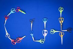 Scissors spelling the word - cut Stock Photos
