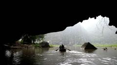 Leg rowing cave local Vietnamese Tam Coc nr Ninh Binh nr Hanoi Asia Stock Footage
