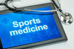 tablet with the text sports medicine on the display - stock illustration