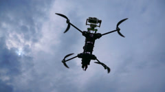 Quadcopter rises up against the sky. View from the bottom up Stock Footage